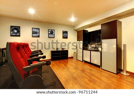 Home TV movie theater entertainment room interior with real cinema chairs. - stock photo
