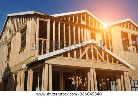 Home Under Construction with Sunlight - stock photo