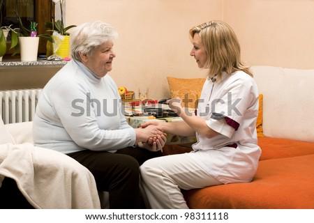 home visit nurse with senior - stock photo