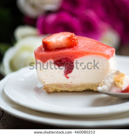 Homebaked Summer Berry Cheesecake with Jelly on the Top made from Raspberries and Strawberries on White Plates