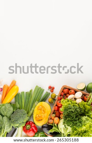 Homegrown vegetables and greens on the table: organic food background - stock photo