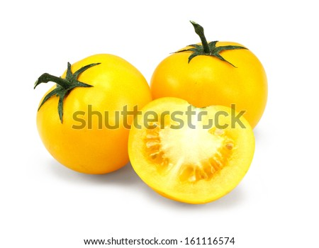 homegrown Yellow tomato harvest from a greenhouse, vegetable produce grown by gardeners - stock photo