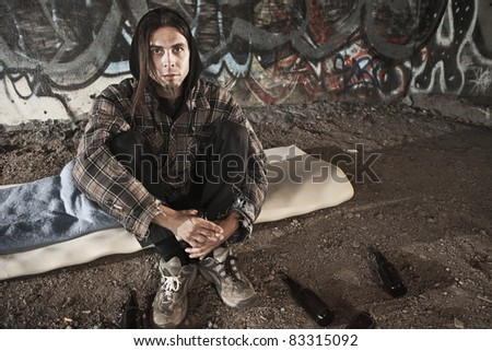 Homeless alcoholic drinking beer - stock photo