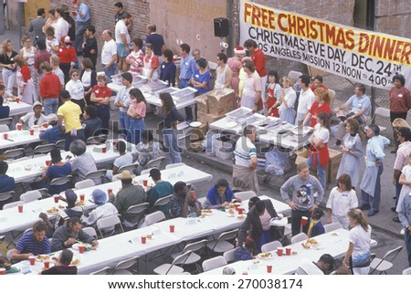 Homeless eating Christmas dinners, Los Angeles, California - stock photo