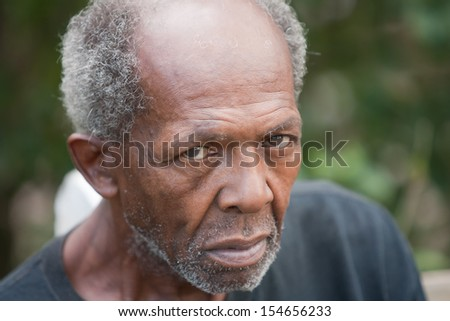 Homeless elderly african american man outside during the day