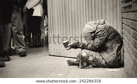homeless girl is begging for money - stock photo