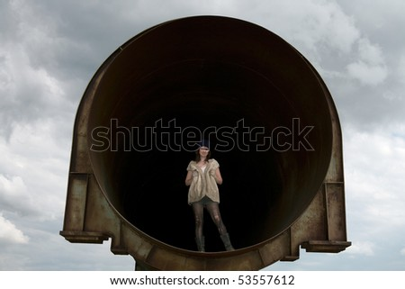 Homeless girl lives in the deserted old pipe in the summer