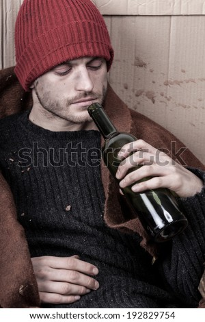 Homeless man addicted to alcohol on the street - stock photo
