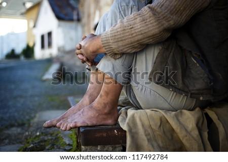 Homeless man feet - stock photo