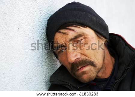 Homeless man in depression. - stock photo