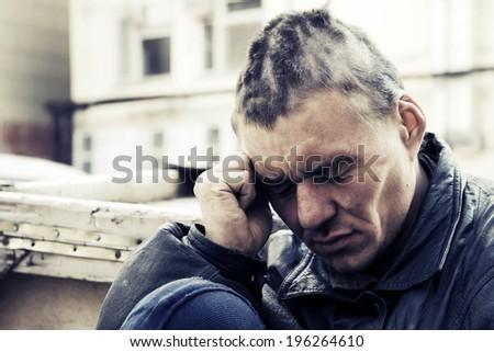 Homeless man in despair - stock photo
