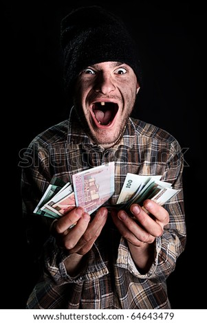 homeless person with money - stock photo
