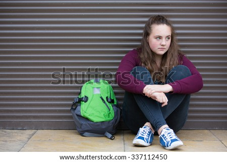 Homeless Teenage Girl On Streets With Rucksack - stock photo