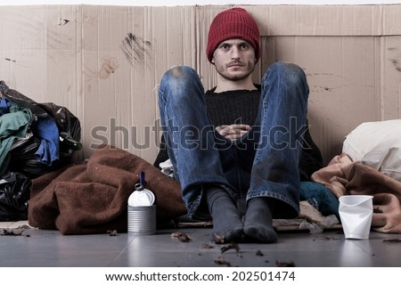 Homeless young man living on the street - stock photo