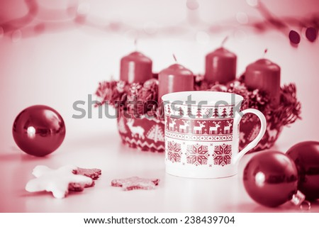 Homely bright red and white christmas decoration with candles, advent wreath, balls, candy star cookies, marsala red colored image - stock photo