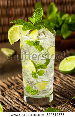 Homemade Alcoholic Mojito with LIme and Green Mint - stock photo