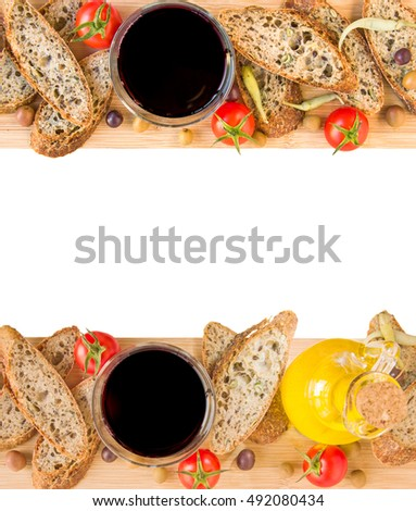 sticks baguette slices olives sun dried tomatoes grapes and wooden ...