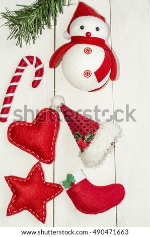 Homemade and mass-produced ornaments for the festive season / Christmas decorations / Handmade snowman,hearts,star,gift-stocking,santa claus hat and candy bar are all handcrafted by yours truly