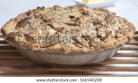 Homemade apple crumb pie with gluten free crust and topping - stock photo