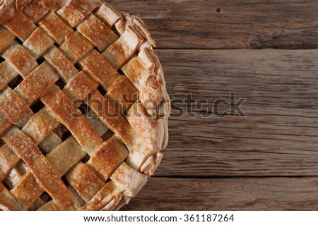 Homemade apple pie dessert on a wooden table closeup. Top view with copy space - stock photo
