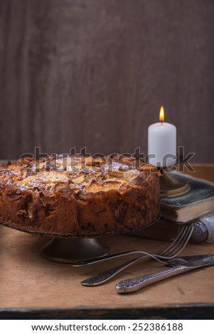 Homemade apple pie on wooden background rustic style - stock photo