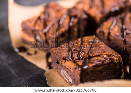 Homemade artisan dark chocolate brownies - stock photo