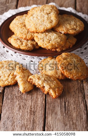 Homemade Australian ANZAC biscuits close up on a plate on the table. vertical