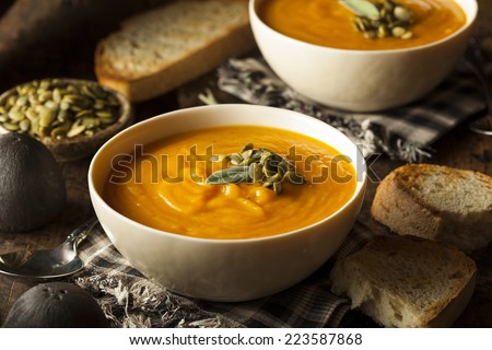 Homemade Autumn Butternut Squash Soup with Bread - stock photo