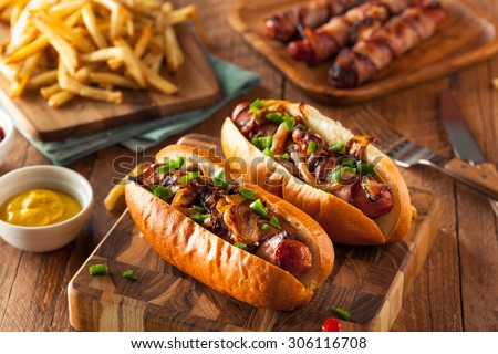 Homemade Bacon Wrapped Hot Dogs with Onions and Peppers - stock photo