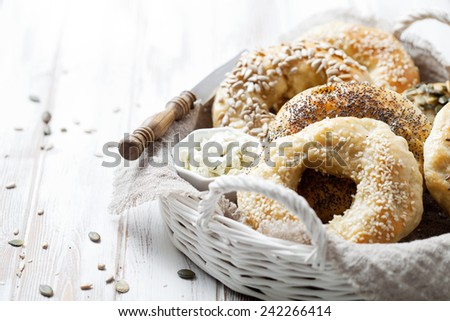 Homemade bagels with sesame, poppy, pumpkin and sunflower seeds - stock photo