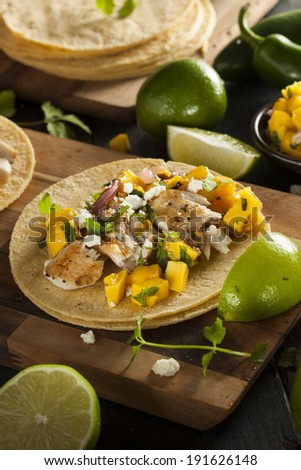 Homemade Baja Fish Tacos with Mango Salsa and Chips - stock photo
