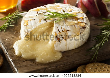 Homemade Baked Brie with Honey and Rosemary - stock photo