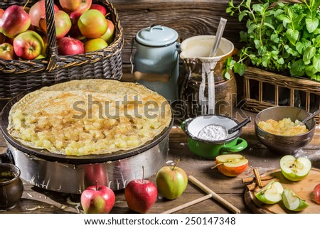 Homemade baking pancakes with apples - stock photo