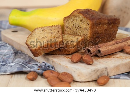 Homemade banana bread sliced on a table . rustic style