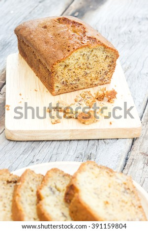 Homemade banana cake on wood plate.