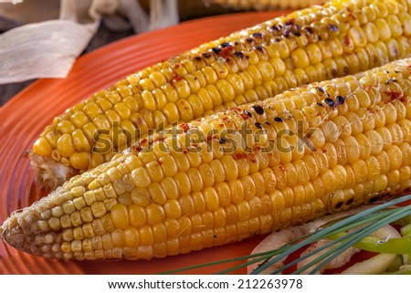 homemade barbecue baked sweet corn with spices - stock photo
