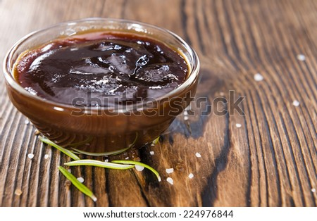 Homemade Barbeque Sauce with Tomatoes, Smoked Salt and fresh Herbs - stock photo