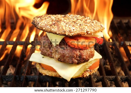 Homemade BBQ Beef Burger On The Hot Flaming Grill. Good Snack For Outdoors Summer Party Or Picnic
