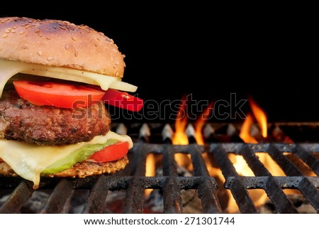 Homemade BBQ Beef Burger On The Hot Flaming Grill. Good Snack For Outdoors Summer Party Or Picnic - stock photo