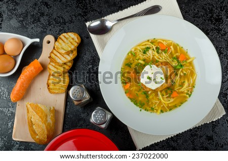 Homemade beef broth, homemade noodles and garlic toast with eggs benedict - stock photo