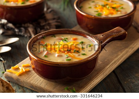 Homemade Beer Cheese Soup with Chives and Bread - stock photo