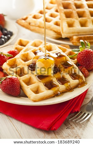 Homemade Belgian Waffles with Strawberries and Maple Syrup