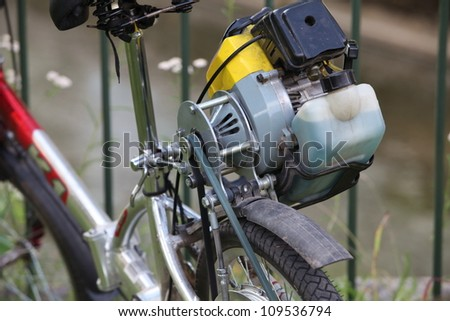 homemade, bicycle with a motor of the lawnmower, fragment - stock photo