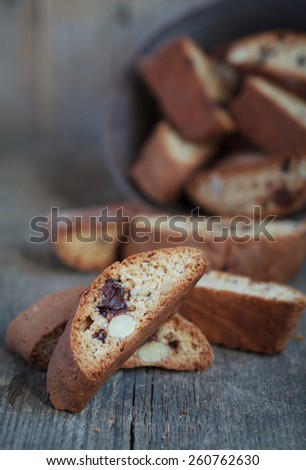 Homemade biscotti with chocolate and almonds on a wooden table, rustic style, selective focus and place for text