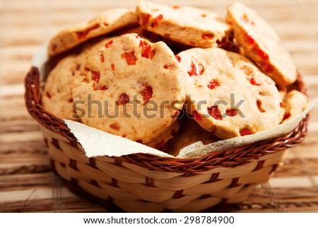 Homemade biscuits with peppers in a basket, close up