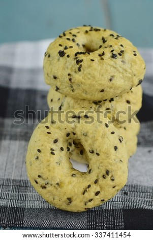 Homemade black sesame seed bagels - stock photo