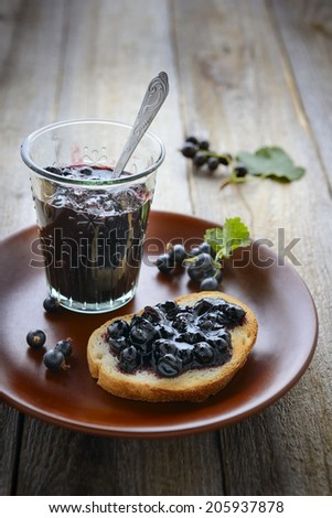 Homemade blackcurrant jam. Rustic style  - stock photo