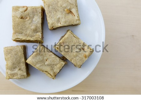 Homemade blondies or white brownies with butterscotch chips.