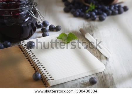 homemade blueberry jam in a jar and fresh blueberries on a table.selective focus. health and diet concept - stock photo