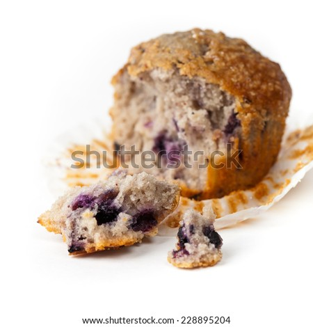 Homemade Blueberry Muffin on White Background. Macro. Selective focus. Extreme shallow DOF. - stock photo